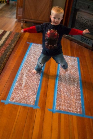 20 fun and easy gross motor play ideas perfect for a rainy day. Indoor toddler activities that get your toddler moving and help develop their body and mind.